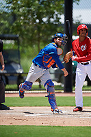 GCL Mets catcher Nelson Mompierre (9) throws to first base during a game against the GCL Nationals on August 4, 2018 at FITTEAM Ballpark of the Palm Beaches in West Palm Beach, Florida.  GCL Nationals defeated GCL Mets 7-4.  (Mike Janes/Four Seam Images)
