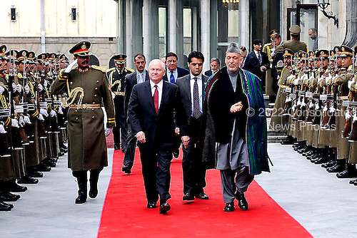 Kabul, Afghanistan - December 8, 2009 -- United States Secretary of Defense Robert M. Gates walks with Afghan President Hamid Karzai  at the presidential palace in Kabul, Afghanistan Tuesday, December 8, 2009. Secretary Gates is on his first trip back to southwest asia after President Obama agreed to send an additional 30,000 troops to Afghanistan. .Mandatory Credit: Jerry Morrison - DoD via CNP