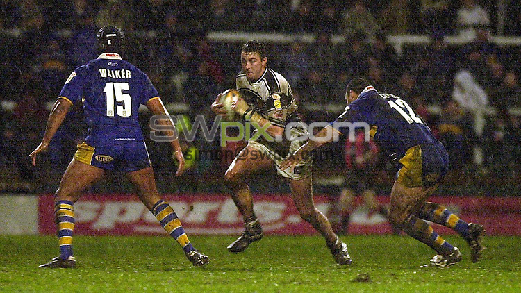 Pix:Ben Duffy/SWpix...Leeds Rhinos v Hull FC.....06/04/2001..COPYRIGHT PICTURE>>SIMON WILKINSON..Leed's Chev Walker and Bradley Clyde try to stop Hull's Paul Cooke