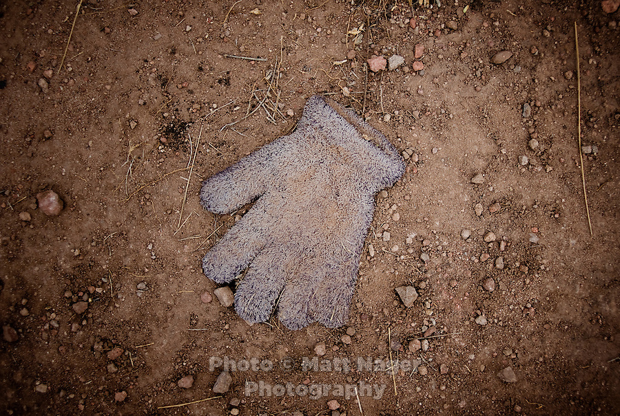 A glove found on a popular migrant crossing trail outside Arivaca, Arizona, July 23, 2009. All too commonly, trash is discarded onto the trails throughout the desert wilderness by migrants crossing the desert from Mexico into the United States. ..PHOTOS/ MATT NAGER