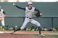 Jake Reed #5 of the Oregon Ducks pitches against the UCLA Bruins at Jackie Robinson Stadium on April 6, 2012 in Los Angeles,California. Oregon defeated UCLA 8-3.(Larry Goren/Four Seam Images)