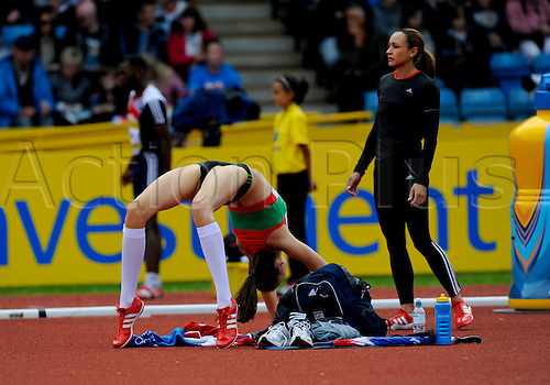 23.06.2012 Birmingham, England. AVIVA 2012  Athletics, Olympic Trials. Isobel Pooley stretches while Jessica Ennis watches the actions at the Women's High Jump in action at the Alexander Stadium.