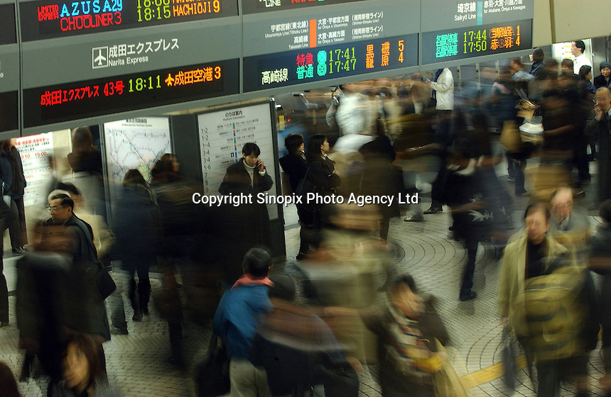 Shinjuku JR train station during peak hours in Tokyo, Japan. Shinjuku is the busiest railway station in the world with several million comuters passing through daily..11 Jan 2005