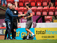 Sheffield Wednesday's manager Steve Bruce, left, and Lincoln City manager Danny Cowley shake hands at the end of the game<br /> <br /> Photographer Chris Vaughan/CameraSport<br /> <br /> Football Pre-Season Friendly - Lincoln City v Sheffield Wednesday - Saturday July 13th 2019 - Sincil Bank - Lincoln<br /> <br /> World Copyright © 2019 CameraSport. All rights reserved. 43 Linden Ave. Countesthorpe. Leicester. England. LE8 5PG - Tel: +44 (0) 116 277 4147 - admin@camerasport.com - www.camerasport.com