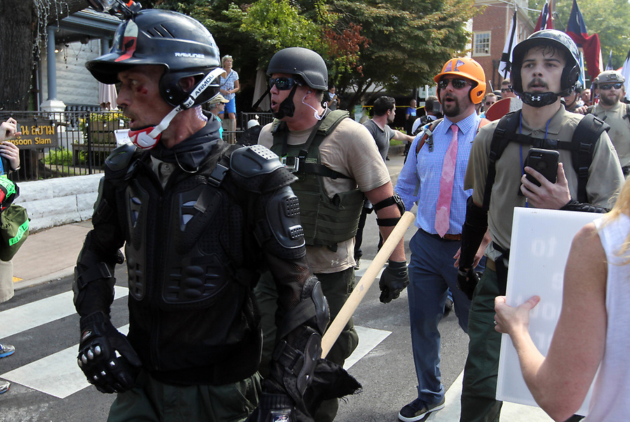 Protestors and counter protestors take to the streets after the Unite the Right rally was declared unlawful by Virginia State Police Saturday, August 12, 2017 in Charlottesville, Va. Photo/Andrew Shurtleff/The Daily Progress