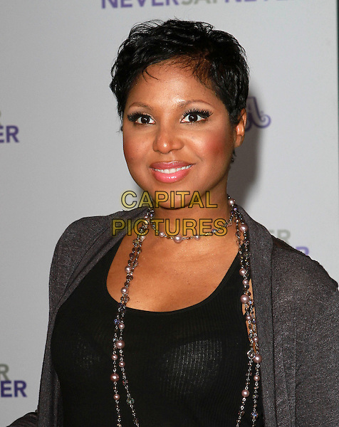 "TONI BRAXTON .Attending ""Justin Bieber: Never Say Never"" Los Angeles Premiere held At Nokia Theatre L.A Live, Los Angeles, California, USA, .8th February 2011..portrait headshot grey gray necklace .CAP/ADM/KB.©Kevan Brooks/AdMedia/Capital Pictures."