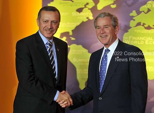 Washington, D.C. - November 15, 2008 -- United States President George W. Bush welcomes Prime Minister Recep Tayyip Erdogan of Turkey to the Summit on Financial Markets and the World Economy leaders to the National Building Museum in Washington, D.C. on Saturday, November 15, 2008..Credit: Ron Sachs / Pool via CNP