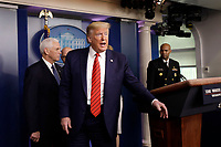 United States President Donald J. Trump replies to journalists questions after a press briefing on the Coronavirus COVID-19 pandemic with members of the Coronavirus Task Force at the White House in Washington on March 19, 2020. At left is US Vice President Mike Pence and at right is US Surgeon General Vice Admiral (VADM) Jerome M. Adams, M.D., M.P.H.<br /> Credit: Yuri Gripas / Pool via CNP/AdMedia