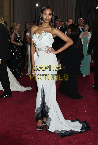 Zoe Saldana (wearing Alexis Mabille Couture).85th Annual Academy Awards held at the Dolby Theatre at Hollywood & Highland Center, Hollywood, California, USA..February 24th, 2013.oscars full length black white grey gray dress hand on hip petal detail bodice ribbon strapless .CAP/ADM/RE.©Russ Elliot/AdMedia/Capital Pictures.