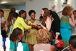 Guests mingling during the African Health Now - Fashion Fete event, at the Tracy Reese store on 641 Hudson Street, June 20, 2013.