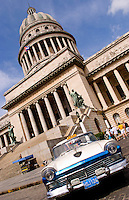 Classic American 50s Ford automobile in front of Capitol building in Havana Cuba Habana