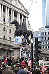G20 meltdown protest outside the Bank of England.  Protesters  climb on the statue of the Duke of Wellington<br /> Thousands of protesters marched on the city of London during the G20 conference meeting in London April 2009 , RBS  Bank windows were smashed on the ground floor. Police made around 90 arrests.