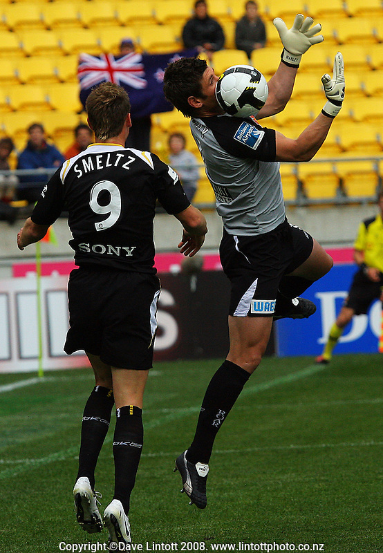 Liam Reddy saves under pressure from Shane Smeltz during the A-League football match between the Wellington Phoenix and Queensland Roar at Westpac Stadium, Wellington. Sunday, 26 October 2008. Photo: Dave Lintott / lintottphoto.co.nz