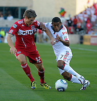 Chicago midfielder Logan Pause (12) battles for the ball with Toronto forward Joao Plata (7).  The Chicago Fire defeated Toronto FC 2-0 at Toyota Park in Bridgeview, IL on August 21, 2011.