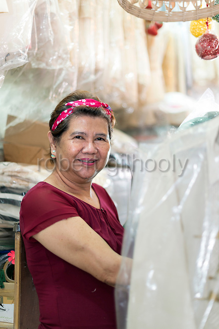 Cress Lontoc poses for a photo inside her store in Taal, Batangas Province, the Philippines on Feb. 9, 2015. Lento specialises in traditional Filipino clothing much as the Barong, which has been a part of Philippine culture for over five centuries.  ROB GILHOOLY PHOTO