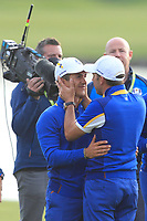 Throbjorn Olesen and Sergio Garcia (Team Europe) hugging on the 18th green after Europe won the Ryder Cup, Le Golf National, Ile-de-France, France. 30/09/2018.<br /> Picture Thos Caffrey / Golffile.ie<br /> <br /> All photo usage must carry mandatory copyright credit (© Golffile | Thos Caffrey)