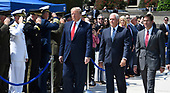 United States President Donald J. Trump (L) walks past an honor guard with the new US Secretary of Defense Dr. Mark T. Esper (R) and US Vice President Mike Pence (C), at the Pentagon, Thursday, July 25, 2019, Washington, DC. The Department of Defense has been without a full-time leader since former Secretary Jim Mattis resigned in December 2018.   <br /> Credit: Mike Theiler / Pool via CNP