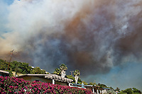 Smoke from Jesusita fire fills sky over house in evacuation zone, Santa Barbara, California, May 6, 2009