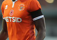 Closeup of Blackpool's Joe Dodoo's shirt, showing the poppy for remembrance<br /> <br /> Photographer Kevin Barnes/CameraSport<br /> <br /> Emirates FA Cup First Round - Exeter City v Blackpool - Saturday 10th November 2018 - St James Park - Exeter<br />  <br /> World Copyright © 2018 CameraSport. All rights reserved. 43 Linden Ave. Countesthorpe. Leicester. England. LE8 5PG - Tel: +44 (0) 116 277 4147 - admin@camerasport.com - www.camerasport.com
