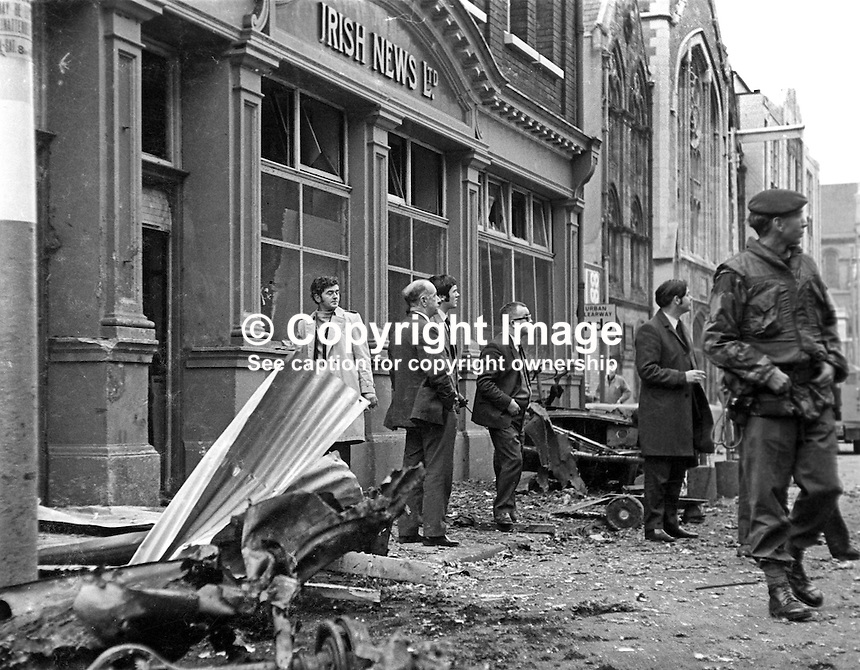 Scene following car bomb explosion at Irish News offices, Upper Donegall Street, Belfast,  N Ireland. Damage was minor and there were no serious injuries. The attack was blamed on the Provisional IRA who it is believed were unhappy with the newspaper's editorial stance. 17th April 1973. 197304140205c.<br />