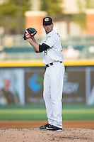 Charlotte Knights starting pitcher Scott Carroll (29) looks to his catcher for the sign against the Durham Bulls at BB&T BallPark on July 22, 2015 in Charlotte, North Carolina.  The Knights defeated the Bulls 6-4.  (Brian Westerholt/Four Seam Images)