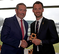 Graham Gooch (L) presents James Foster (R) with his County Championship winning medal during the Lord's Taverners Presentation at Lord's Cricket Ground on 12th March 2018