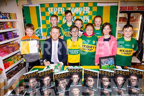 Pictured at Colm Coopers book signing in Quirkes Newsagents in Cahersiveen on Friday evening were front l-r; Tadhg O'Leary, Colm Cooper, Sean O'Sullivan, Ellen O'Leary, Hannah Murphy, Aodhan Mangan, back l-r; Ronan O'Dowd, Daragh Murphy, Sean Daly & Aine Daly.