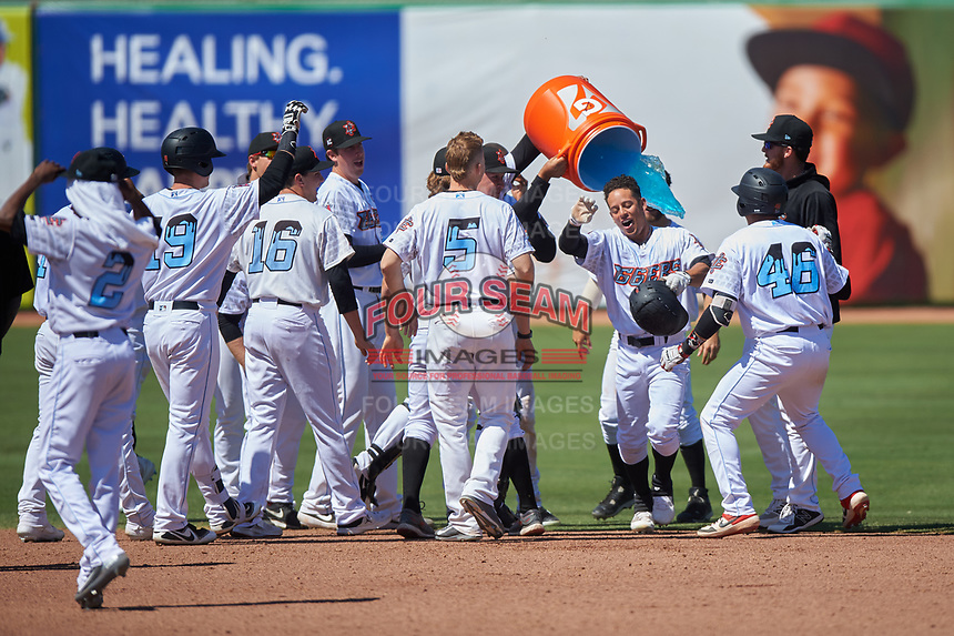Inland Empire 66ers shortstop Leonardo Rivas (3) has Gatorade dumped on him after hitting a walk-off double during a California League game against the Modesto Nuts on April 10, 2019 in San Bernardino, California. Inland Empire defeated Modesto 5-4. (Zachary Lucy/Four Seam Images)