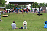 MEGAN DAVIS/MCDONALD COUNTY PRESS Southern Tradition serenades the crowd during the Berries, Bluegrass and BBQ Festival on Saturday. After being rained out, the weather cleared and festival-goers enjoyed the lawn and creek in Town Hole.