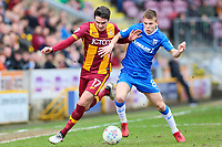 Alex Gilliead of Bradford City and Jake Hessenthaler of Gillingham during the Sky Bet League 1 match between Bradford City and Gillingham at the Northern Commercial Stadium, Bradford, England on 24 March 2018. Photo by Thomas Gadd.