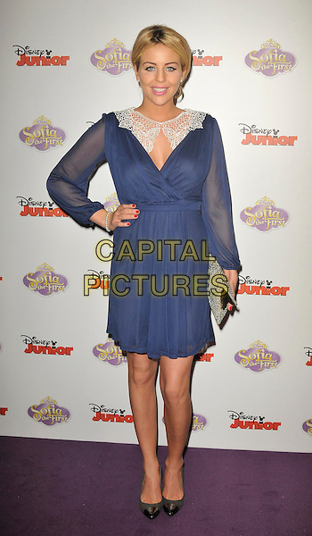 Lydia Rose Bright .The launch of the Disney TV Series 'Sofia The First' at the Mayfair Hotel, London, England..22nd February 2013  .full length hand on hip blue dress sheer white lace  wrap grey gray black shoes clutch bag.CAP/WIZ.© Wizard/Capital Pictures.