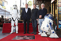 HOLLYWOOD, CA - MARCH 8: Harrison Ford, Mark Hamill, George Lucas, at Mark Hamill Honored With Star On The Hollywood Walk Of Fame At Hollywood Blvd in Hollywood, California on March 8, 2018. <br /> CAP/MPI/FS<br /> &copy;FS/MPI/Capital Pictures