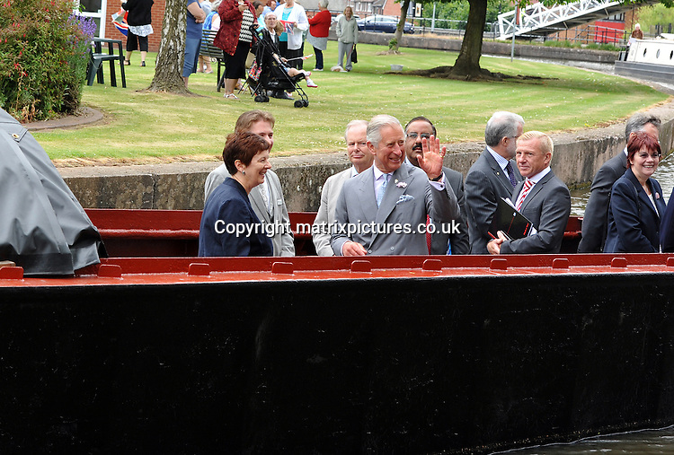 NON EXCLUSIVE PICTURE: MATRIXPICTURES.CO.UK<br /> PLEASE CREDIT ALL USES<br /> <br /> WORLD RIGHTS<br /> <br /> Prince Charles of Wales is pictured as he visits the Etruria Industrial Museum in Stoke on Trent, Staffordshire. <br /> <br /> JUNE 24th 2014<br /> <br /> REF: IWD 142991