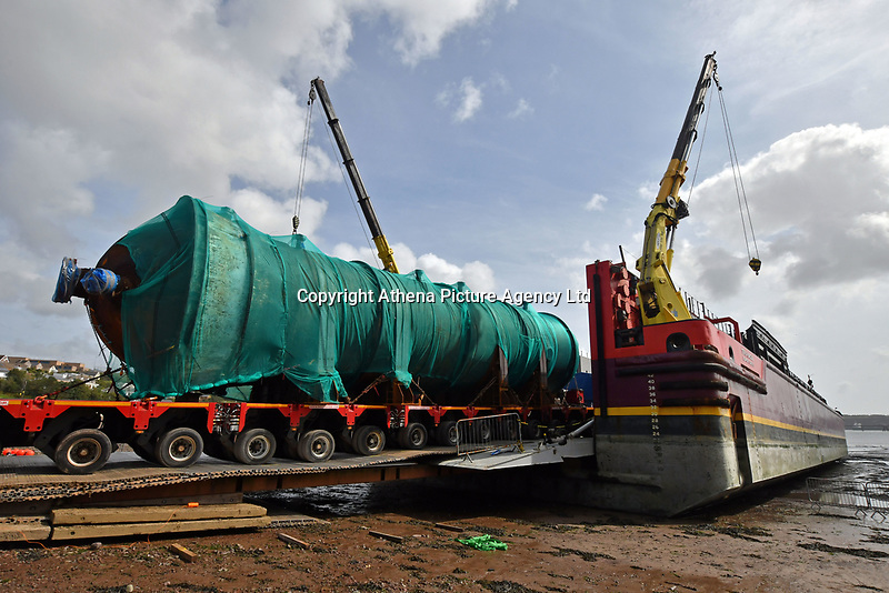 Pictured: 200 ton column being loaded onto barge at Gelliswick Bay, Wales, UK<br /> Re: A large dismantled section of an oil refinery has been taken away by road ready to be shipped and rebuilt in Pakistan.<br /> Policing units escorted it on the five-hour journey from the former Murco site in Milford Haven, Pembrokeshire, to Gelliswick Bay on Tuesday.<br /> About 600 people once worked there but it closed in November 2014.<br /> It is now a storage facility, with about 100 people carrying out decommissioning work over two years.<br /> The load will remain on the beach overnight before being taken away by barge on 6 September.<br /> Decommissioning is set to be completed in Autumn 2018, with the whole refinery being re-assembled in Pakistan.