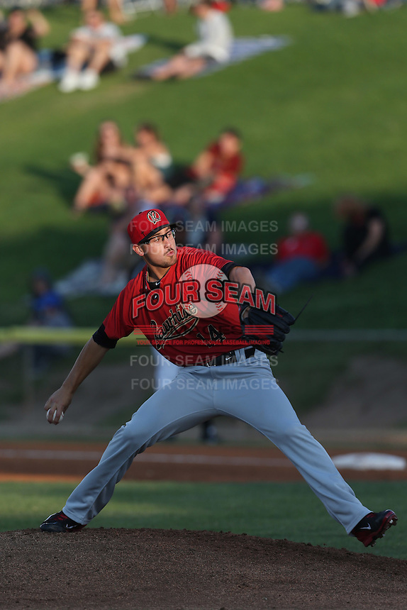 Branden Shipley #14 of the Visalia Rawhide pitches against the High Desert Mavericks at Heritage Field on July 19, 2014 in Adelanto, California. Visalia defeated High Desert, 10-9. (Larry Goren/Four Seam Images)
