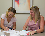 Maddison Weiss-Frank, left, gets the details of her scholarship from Board Member Amanda Alfaro during the Nevada Women's Fund Scholarship distribution, June 20, 2019.