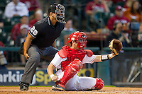 Houston Cougars catcher John Cannon #37 sets a target as home plate umpire Michael Bank looks on during the game against the Arkansas Razorbacks at Minute Maid Park on March 3, 2012 in Houston, Texas.  The Cougars defeated the Razorbacks 4-1.  (Brian Westerholt/Four Seam Images)