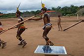 Xingu Indigenous Park, Mato Grosso State, Brazil. Aldeia Matipu (Matipu). Taquara Festival. Solar panel