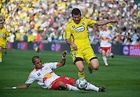 Alejandro Moreno dribbles through a tackle during MLS Cup 2008. Columbus Crew defeated the New York Red Bulls, 3-1, Sunday, November 23, 2008. Photo by John Todd/isiphotos.com