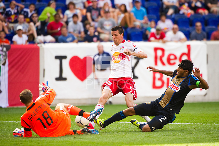 Philadelphia Union goalkeeper Zac MacMath (18) makes a stop on Kenny Cooper (33) of the New York Red Bulls. The New York Red Bulls defeated the Philadelphia Union 2-0 during a Major League Soccer (MLS) match at Red Bull Arena in Harrison, NJ, on July 21, 2012.