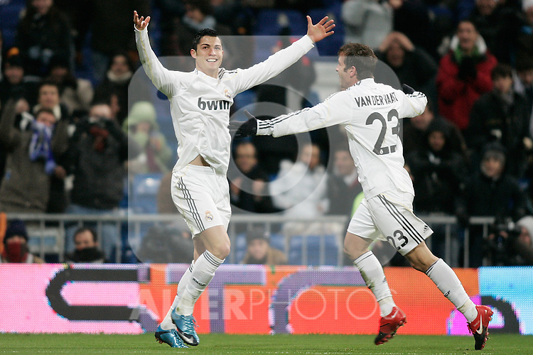 Real Madrid's Cristiano Ronaldo celebrates with Rafael van der Vaart during La Liga match, December 19, 2009. (ALTERPHOTOS/Alvaro Hernandez).