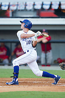 Logan Moon (18) of the Burlington Royals follows through on his swing against the Johnson City Cardinals at Burlington Athletic Park on July 14, 2014 in Burlington, North Carolina.  The Cardinals defeated the Royals 9-4.  (Brian Westerholt/Four Seam Images)