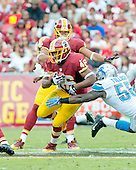 Washington Redskins running back Alfred Morris (46) is pursued by Detroit Lions linebacker Stephen Tulloch (55) in the second quarter at FedEx Field in Landover, Maryland on Sunday, September 22, 2013.<br /> Credit: Ron Sachs / CNP