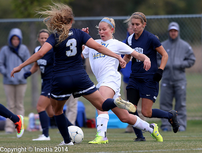 BROOKINGS, SD - OCTOBER 12: Tori Poole #21 from South Dakota State splits defenders Ashley Martin #3 and Madison Valenzuela #11 from Oral Roberts University in the first half of their game Sunday afternoon at Fischback Soccer Field in Brookings. (Photo by Dave Eggen/Inertia)