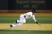 Chris Lanzilli (24) of the Wake Forest Demon Deacons dives back towards first base during the game against the North Carolina State Wolfpack at David F. Couch Ballpark on April 18, 2019 in  Winston-Salem, North Carolina. The Demon Deacons defeated the Wolfpack 7-3. (Brian Westerholt/Four Seam Images)