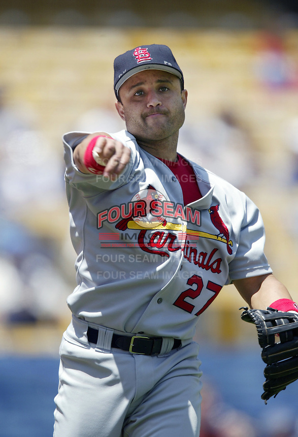 Placido Polanco of the St. Louis Cardinals throws before a 2002 MLB season game against the Los Angeles Dodgers at Dodger Stadium, in Los Angeles, California. (Larry Goren/Four Seam Images)