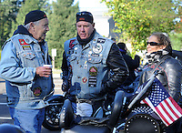 BENSALEM, PA - OCTOBER 5: From left, Jim Donnelly, of Bensalem, Pennsylvania, Jim Miller of Levittown, Pennsylvania and Susan Miller of Levittown, Pennsylvania chat before the Libertae 10th Annual Biker's and Babes Ride October 5, 2014 in Bensalem, Pennsylvania.  Libertae, a women's substance abuse treatment center, hosted the event, which runs through Bucks County before ending at Core Creek Park. (Photo by William Thomas Cain/Cain Images)