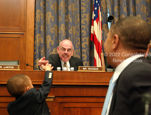 "Washington, D.C. - May 19, 2005 -- William Lacy Clay, left, young son of United States Representative William Lacy Clay, Jr. (Democrat of Missouri), left, gives a hand slap to United States Representative Henry A. Waxman (Democrat of California), center, during testimony before tghe United States House of Representatives Committee on Government Reform on ""Steroid Use in Sports Part III: Examining the National Basketball Association's (NBA) Steroid Testing Program""  in Washington, D.C. on May 17, 2005.  .Credit: Ron Sachs / CNP..(RESTRICTION: NO New York or New Jersey Newspapers or newspapers within a 75 mile radius of New York City)"