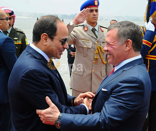 Egyptian President Abdel Fattah al-Sisi greets Jordan's King Abdullah II during a welcome ceremony in the Egyptian capital Cairo,  on May 17, 2017. Photo by Egyptian President Office
