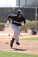 Esteilon Peguero #17 of the Seattle Mariners participates in spring training workouts at the Mariners minor league complex at Peoria Sports Complex on March 27, 2011  in Peoria, Arizona. .Photo by:  Bill Mitchell/Four Seam Images.